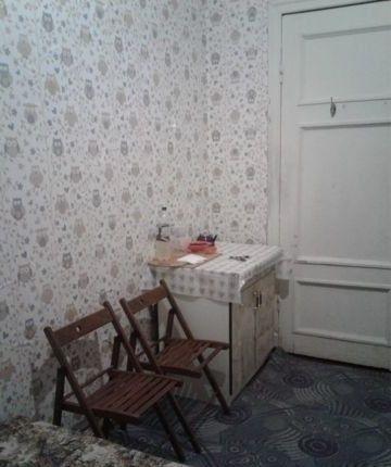 Комната в коммуналке.